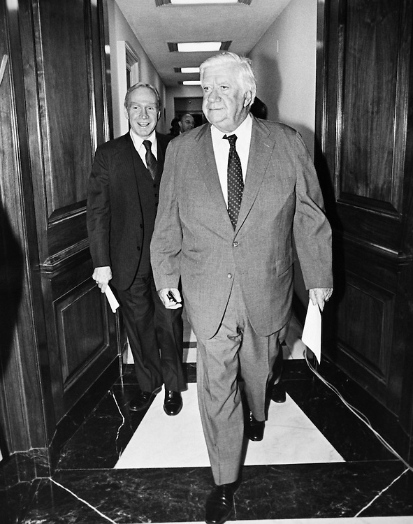 Rep. Jim Wright, D-Texas, and other party leaders walking in corridor. (Photo by CQ Roll Call)