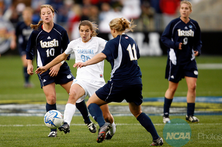 03 DEC 2006:  A crowd of Notre Dame University players pressure Tobin Heath (98)  of the University of North Carolina during the Division I Women's Soccer Championship held at the SAS Soccer Park in Cary, NC.  North Carolina defeated Notre Dame 2-1 for the national title.  Jamie Schwaberow/NCAA Photos