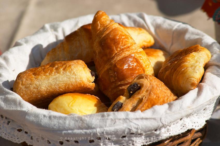 A wicker breakfast basket with croissants, and chocolate breads (pain au chocolat) Clos des Iles Le Brusc Six Fours Cote d'Azur Var France