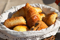 A wicker breakfast basket with croissants, and chocolate breads (pain au chocolat) Clos des Iles Le Brusc Six Fours Cote d'Azur Var France