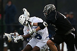 01 March 2015: Providence's Michael Perettine (right) fouls Duke's Myles Jones (left). The Duke University Blue Devils hosted the Providence College Friars on the West Turf Field at the Duke Athletic Field Complex in Durham, North Carolina in a 2015 NCAA Division I Men's Lacrosse match. Duke won the game 20-8.