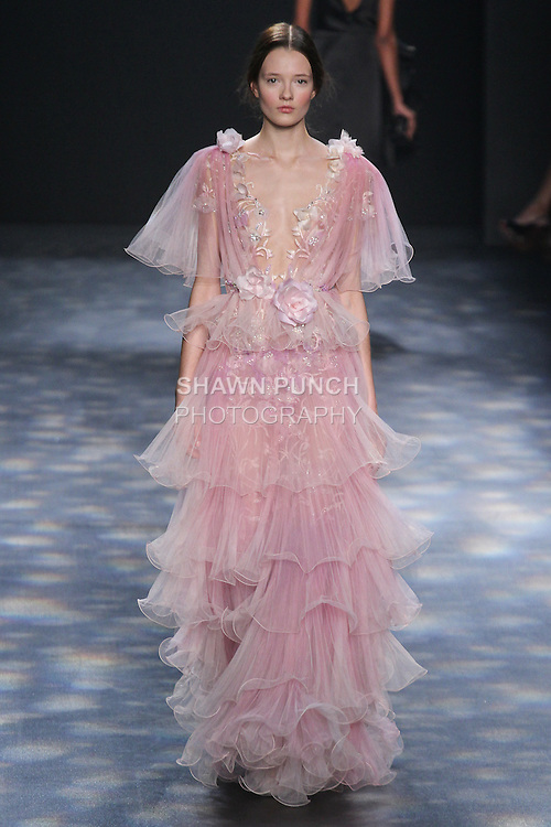 Model Alicja walks runway in a pink ombré wire-hemmed pleated tulle gown with bluch and ivory floral threadwork embroidery, from the Marchesa Fall 2016 collection by Georgina Chapman and Keren Craig, presented at NYFW: The Shows Fall 2016, during New York Fashion Week Fall 2016.