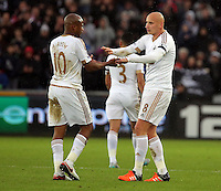 Jonjo Shelvey of Swansea (R) celebrates his goal with co-scorer Andre Ayew of Swansea (L) during the Barclays Premier League match between Swansea City and Bournemouth at the Liberty Stadium, Swansea on November 21 2015