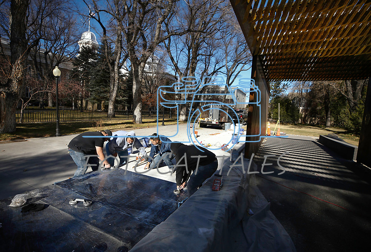 A Premier Tile and Stone crew makes repairs to the Battle Born Memorial at the Capitol, in Carson City, on Monday, Dec. 17, 2018. The memorial, honoring Nevada&rsquo;s 895 fallen service members, was damaged by four teens on bikes and scooters just days after it was dedicated.  <br /> Photo by Cathleen Allison/Nevada Momentum