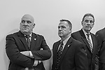 Mineola, NY, USA. March 5, 2012. At Nassau County Legislature meeting when legislators vote to confirm Thomas Dale as Police Commissioner and to consolidate 8 police precincts into 4, are, L-R, Nassau PBA President JAMES CARVER, who spoke against closing precincts; PBA's Sergeant-at-arms JAMES McDERMOTT; and President of Superior Officers (SOA) GARY LEARNED.