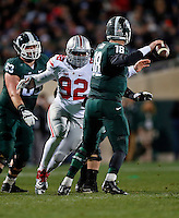 Ohio State Buckeyes defensive lineman Adolphus Washington (92) pressures Michigan State Spartans quarterback Connor Cook (18) during Ohio State's 49-37 win over Michigan State in the NCAA football game at Spartan Stadium in East Lansing, Michigan on Nov. 8, 2014. (Adam Cairns / The Columbus Dispatch)