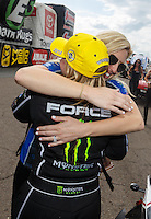 Mar 20, 2016; Gainesville, FL, USA; NHRA top fuel driver Brittany Force (left) celebrates with sister Courtney Force after winning the Gatornationals at Auto Plus Raceway at Gainesville. Mandatory Credit: Mark J. Rebilas-USA TODAY Sports