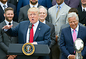 United States President Donald J. Trump makes remarks welcoming the Super Bowl Champion New England Patriots to the South Lawn of White House in Washington, DC on Wednesday, April 19, 2917.  Patriots owner Robert Kraft can be seen at right.<br /> Credit: Ron Sachs / CNP<br /> (RESTRICTION: NO New York or New Jersey Newspapers or newspapers within a 75 mile radius of New York City)