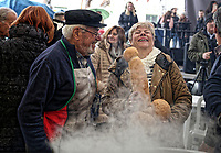 Pictured: A man and a woman holding a penis-shaped loaf of bread share a joke in Tirnavos, central Greece. 19 February 2018<br /> Re: Bourani (or Burani) the infamous annual carnival which dates to 1898 which takes place on the day of (Clean Monday), the first days of Lent in Tirnavos, central Greece, in which men hold phallus shaped objects as scepters in their hands.