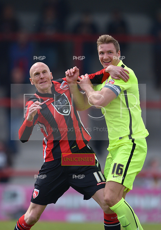 07/05/2016 Sky Bet League Two Morecambe v York City<br /> Kevin Ellison tangles with Dave Winfield