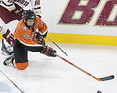 Brandon Svendsen 23 of Bowling Green reaches for the puck as he falls. The Eagles of Boston College defeated the Falcons of Bowling Green State University 5-1 on Saturday, October 21, 2006, at Kelley Rink of Conte Forum in Chestnut Hill, Massachusetts.<br />