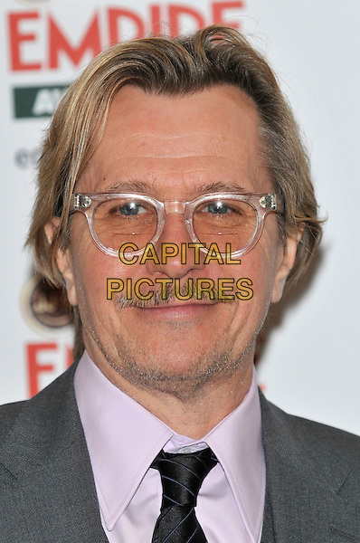 GARY OLDMAN.The Jameson Empire Film Awards at the Grosvenor House Hotel, Park Lane, London, England, UK..March 27th 2011.headshot portrait black white grey gray glasses moustache mustache facial hair .CAP/PL.©Phil Loftus/Capital Pictures.