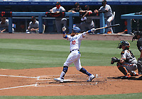 25th July 2020, Los Angeles, California, USA;  Los Angeles Dodgers third baseman Justin Turner (10) hits a double to drive in a run during the first inning of the game against the San Francisco Giants on July 25, 2020, at Dodger Stadium in Los Angeles, CA.