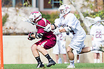 Los Angeles, CA 02/17/14 - unidentified Santa Clara player(s) and Kyle Mendelson (LMU #44) in action during the Santa Clara University - Loyola Marymount University MCLA's Men's lacrosse game at Loyola Marymount University.  Santa Clara defeated LMU 11-10 in overtime.