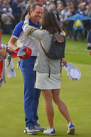 Sergio Garcia (Team Europe) hugs his wife, Angela, after winning the hole and his match on 17 following Sunday's singles of the 2018 Ryder Cup, Le Golf National, Guyancourt, France. 9/30/2018.<br /> Picture: Golffile | Ken Murray<br /> <br /> <br /> All photo usage must carry mandatory copyright credit (© Golffile | Ken Murray)