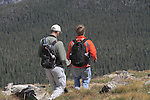 Father and son hiking the Flattop Mountain Trail in Rocky Mountain National Park, west of Estes Park, Colorado.