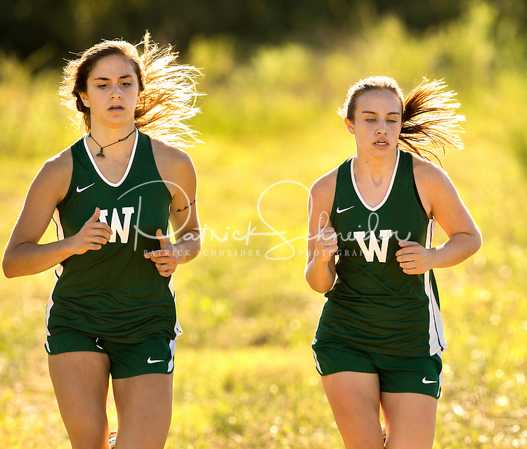 Photography of the Woodlawn School Varsity Cross Country team running Monday afternoon September 14, 2016 at Christ The King School in Huntersville, NC.<br /> <br /> Charlotte Photographer - PatrickSchneiderPhoto.com