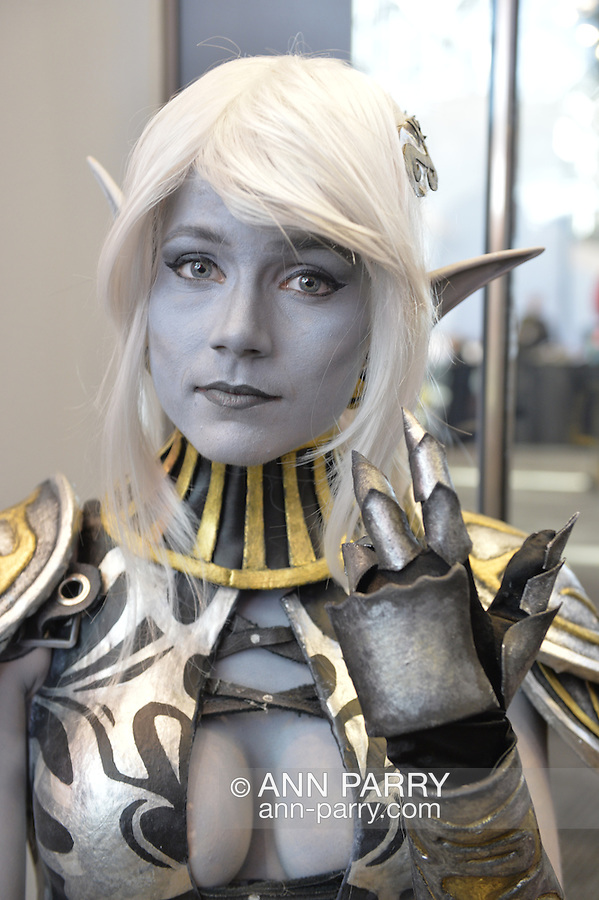 Manhattan, New York City, New York, USA. October 10, 2015. ANNE POUW, a cosplayer from the Netherlands, portrays the character PYURROT at the 10th Annual New York Comic Con. NYCC 2015 is expected to be the biggest one ever, with over 160,000 attending during the 4 day ReedPOP event, from October 8 through Oct 11, at Javits Center in Manhattan