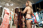 Customers wearing swimsuits hold their shopping during the ''Seminaked in Red'' event at Desigual Harajuku store on June 27, 2015, Tokyo, Japan. Spanish fashion label's promotional event offered the first 100 participants who arrived wearing swimsuits a discount on all in store items. According to the organizers around 100 people lined up over night despite the heavy rain. (Photo by Rodrigo Reyes Marin/AFLO)
