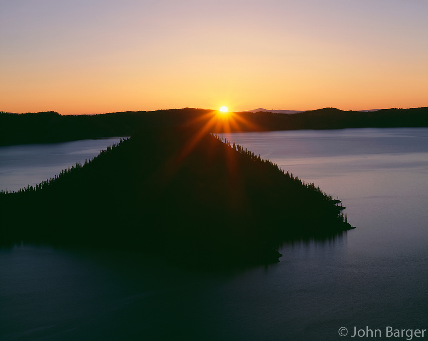ORCL_027 - USA, Oregon, Crater Lake National Park, Sunrise over Wizard Island and Crater Lake.