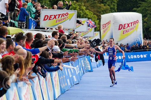 07 AUG 2011 - LONDON, GBR - Alistair Brownlee (GBR) celebrates winning the men's round of triathlon's ITU World Championship Series and meeting the selection criteria for the British team for the 2012 Olympic Games (PHOTO (C) NIGEL FARROW)