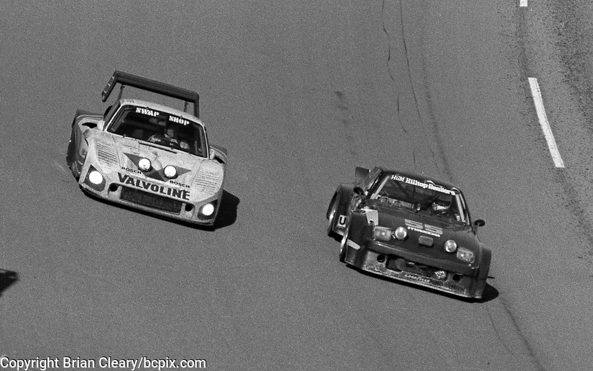 The #6 Porsche 935L of A.J. Foyt, Bob Wollek and Derek Bell races past the #55 Mazda RX-7 of Richard Stevens, Mark Brainard, and Don Herman during the SunBank 24 at Daytona, Daytona International Speedway, Daytona Beach, FL, Feb. 4-5, 1984. (Photo by Brian Cleary/www.bcpix.com)