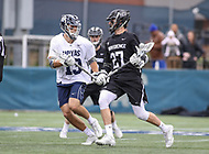 Washington, DC - April 7, 2018: Providence Friars Ryan Nawrocki (27) gets pass Georgetown Hoyas Ryan Hursey (13) during game between Providence and Georgetown at  Cooper Field in Washington, DC.   (Photo by Elliott Brown/Media Images International)