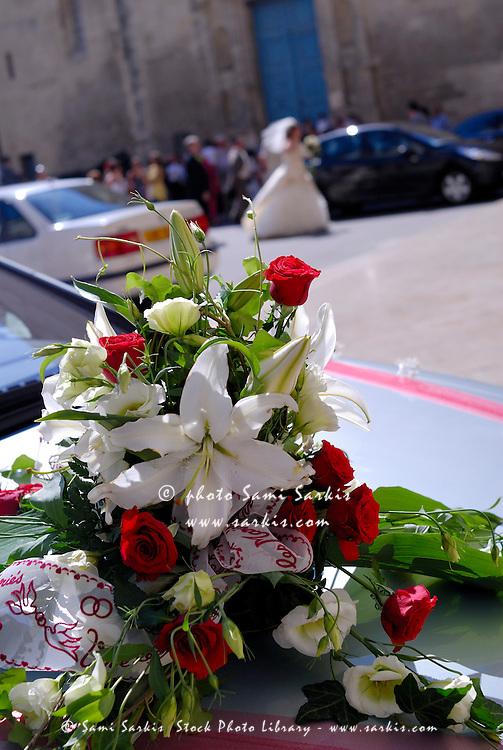 Wedding bouquet on car