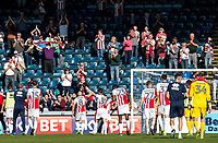 The Cheltenham Town players are applauded by the travelling fans after they earned a valuable point playing with 10 men for the majority of the match during the Sky Bet League 2 match between Wycombe Wanderers and Cheltenham Town at Adams Park, High Wycombe, England on the 8th April 2017. Photo by Liam McAvoy.
