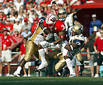 Madison, Wisconsin - 9/6/2003.  University of Wisconsin wide receiver Lee Evans (3) catches a pass during the University of Akron football game at Camp Randall. Evans had 9 catches for 214 yards. Wisconsin beat Akron 48-31. (Photo by David Stluka).