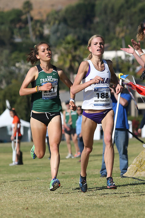 November 2, 2013; Malibu, CA, USA; San Francisco runner Bridget Dahlberg (221) and Portland runner Laura Hottenrott (188) during the WCC Cross Country Championship at Alumni Park.