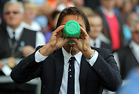 Manager of Chelsea, Antonio Conte drinks water during the Premier League match between Swansea City and Chelsea at The Liberty Stadium on September 11, 2016 in Swansea, Wales.