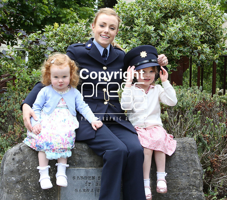 23/7/2015.    Graduating from the Garda College in Templemore this Thursday were graduating Garda Ciara Byrne from Lusk who is stationed at Mountjoy with her two daughter Lara(2) and Olivia(3).<br /> Photograph Liam Burke/Press 22