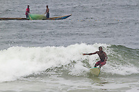 "Two Time Liberian Champion Alfred Lomax surfs the wave called ""Shipwrecks"" in Robertsport, Liberia. Lomax grew up in a traditional fishing family, and now seeks to be Liberia's first professional surfer."