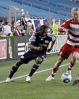 New England Revolution midfielder Sainey Nyassi (14) dribbles along the sideline as FC Dallas midfielder/forward Brek Shea(20) prepares to tackle.  The New England Revolution drew FC Dallas 1-1, at Gillette Stadium on May 1, 2010