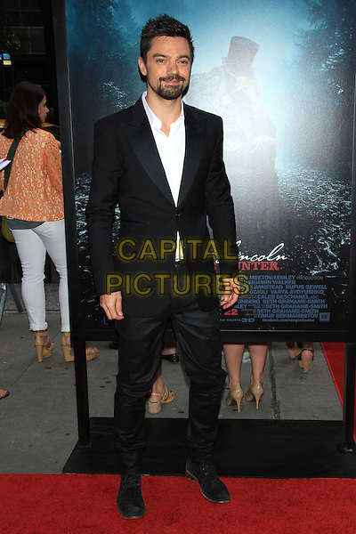 "Dominic Cooper.The Premiere of ""Abraham Lincoln: Vampire Hunter"" at the AMC Loews Lincoln Square Cinemas, New York, NY., USA..June 18th, 2012.full length black suit white shirt beard facial hair .CAP/LNC/TOM.©LNC/Capital Pictures."