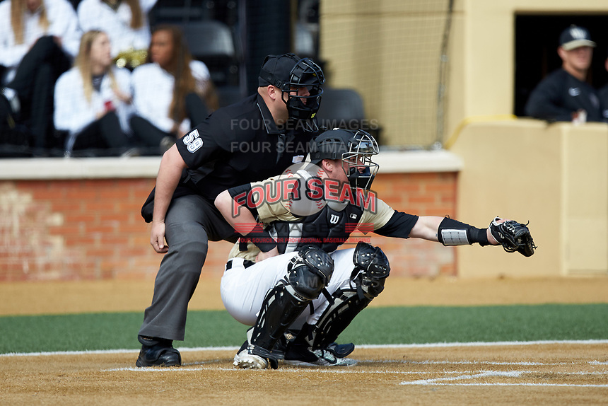 Wake Forest Demon Deacons catcher Shane Muntz (11) frames a pitch as home plate umpire Wilson Raynor looks on during the game against the Louisville Cardinals at David F. Couch Ballpark on March 18, 2018 in  Winston-Salem, North Carolina.  The Demon Deacons defeated the Cardinals 6-3.  (Brian Westerholt/Four Seam Images)