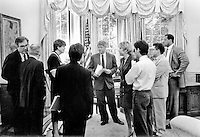 United States President Bill Clinton meets with Attorney General Janet Reno in the Oval Office of the White House in Washington, D.C. on Thursday, June 24, 1993.  White House Counsel Vince Foster, far left, is whispering into the ear of fellow counsel Bernard Nussbaum.  Press Secretary Dee Dee Myers is at the immediate right of The President..Credit: White House via CNP /MediaPunch