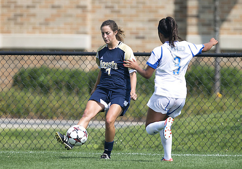 September 01, 2013:  Notre Dame forward Rebecca Twining (7) passes the ball as UCLA midfielder Caprice Dydasco (3) defends during NCAA Soccer match between the Notre Dame Fighting Irish and the UCLA Bruins at Alumni Stadium in South Bend, Indiana.  UCLA defeated Notre Dame 1-0.