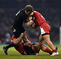 Conrad Smith of New Zealand is double-tackled. Rugby World Cup Pool C match between New Zealand and Georgia on October 2, 2015 at the Millennium Stadium in Cardiff, Wales. Photo by: Patrick Khachfe / Onside Images