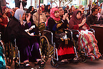Palestinian elderly take part during a celebration on the occasion of Mother's Day, at el-Wafa elderly nursing home in Gaza city, on March 21, 2019. Mother's Day is a celebration honoring the mother of the family, as well as motherhood, maternal bonds, and the influence of mothers in society. It is celebrated on various days in many parts of the world, most commonly in the months of March or May. It complements similar celebrations honoring family members, such as Father's Day, Siblings Day, and Grandparents Day. Photo by Mahmoud Ajjour