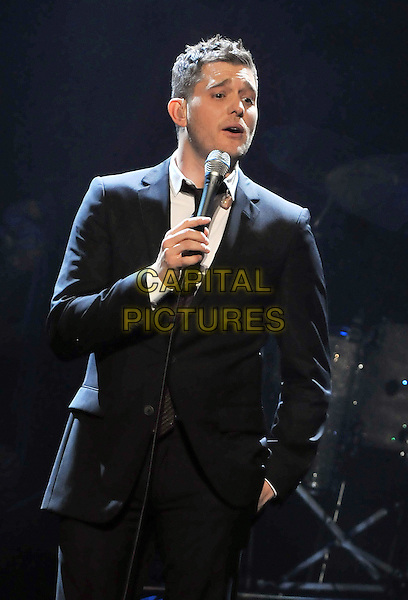 "MICHAEL BUBLE .performs in concert as a part of his ""Crazy Love Tour"" held at the CSU Convocation Center, Cleveland, Ohio, USA, 23rd March 2010..music gig live on stage  half length microphone black suit tie hand singing in pocket                             .CAP/ADM/DS.©Devin Simmons/AdMedia/Capital Pictures."