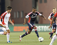 New England Revolution defender Andrew Farrell (2) brings the ball forward.  In a Major League Soccer (MLS) match, Toronto FC (white/red) defeated the New England Revolution (blue), 1-0, at Gillette Stadium on August 4, 2013.