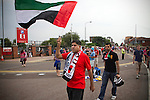 Uruguay 2 United Arab Emirates 1, Great Britain 1 Senegal 1, 26/07/2012. Old Trafford, Olympic Games. A supporter of the United Arab Emarites football team walking towards Manchester United's Old Trafford stadium prior to the Men's Olympic Football tournament matches at the venue. The double header of matches resulted in Uruguay defeating the United Arab Emirates by 2-1 while Great Britain and Senegal drew 1-1. Over 72,000 spectators attended the two Group A matches. Photo by Colin McPherson.