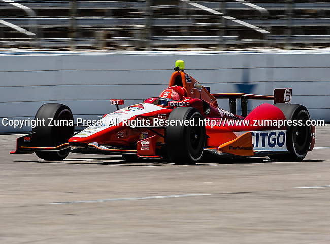 E.J. Viso (5) driver of the CITGO/PDVSA KV Racing Technology car in action during qualifying for the IZOD Indycar Firestone 550 race at Texas Motor Speedway in Fort Worth,Texas. IZOD Indycar driver Alex Tagliani (98) driver of the Team Barracuda-BHA car qualifies in the top spot during the Firestone 550 race..