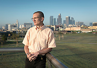 """Tom Carroll '08's YouTube videos explore the forgotten fringes of the City of Angels, while schooling viewers about some lesser-known landmarks.<br /> Over the last four years, the Southern California native has produced more than two dozen episodes of his YouTube series """"Tom Explores Los Angeles,"""" which offers off-the-beaten-path looks at the seemingly mundane but history-rich spots that dot the city's landscape.<br /> Photographed March 13, 2017.<br /> (Photo by Marc Campos, Occidental College Photographer)"""