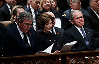 Former President George W. Bush, right, former first lady Laura Bush and former Florida Gov. Jeb Bush participate in a State Funeral for former President George H.W. Bush at the National Cathedral, Wednesday, Dec. 5, 2018, in Washington. <br /> CAP/MPI/RS<br /> &copy;RS/MPI/Capital Pictures