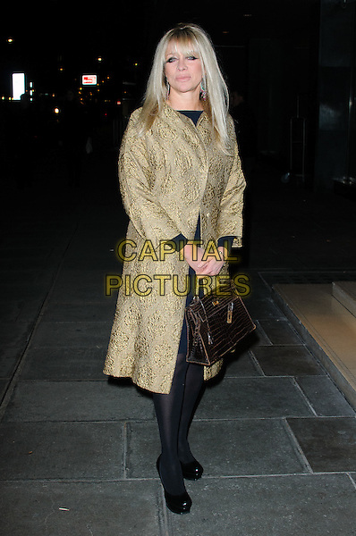 Jo Wood.The Rodial Beautiful Awards 2012, held at the Sanderson - Arrivals .London, England..March 6th, 2012.full length black tights gold coat brown bag purse .CAP/CJ.©Chris Joseph/Capital Pictures.