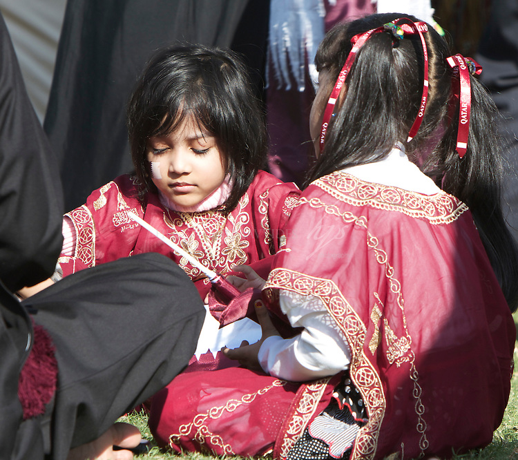 Children wearing traditional Qatari costume, National Day, Doha, Qatar | Dec 10