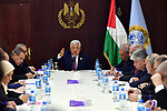 Palestinian President Mahmoud Abbas meets with the new government following the swearing ceremony at the Palestinian Authority's headquarters in the West Bank town of Ramallah, 13 April 2019. Photo by Thaer Ganaim